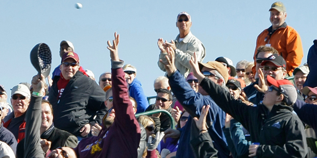 "Fans reach for a golf ball thrown into the stands on the 16th green during the first round of the Phoenix Open PGA golf tournament Friday, Feb. 4, 2011, in Scottsdale, Ariz. The tournament's notoriously rambunctious 162-yard, Par-3 16th green, dubbed the ""Rowdiest Hole in Golf"", is completely engulfed by skyboxes and bleachers that can hold up to 20,000 fans. (AP Photo/Matt York)"